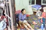 Seorang ibu luka, bangunan indekos roboh