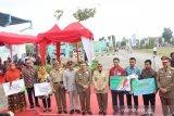 Menaker serahkan santunan BPJamsostek korban kecelakaan kerja Riau