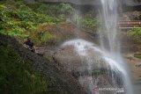Destinasi wisata tersembunyi, Air Terjun Batu Tilam di Riau