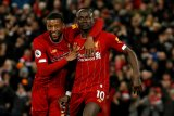 Empat kali lagi menang, Liverpool di ambang banjir rekor