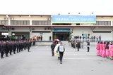 Jenazah Bharatu Doni Priyanto dilepas secara militer di Bandara Juanda