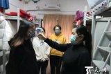 Xinjiang membantah penahanan pelajar di Wuhan