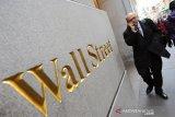 Wall Street hentikan kerugian, terangkat raksasa teknologi