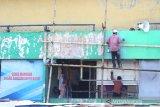 Warga beraktivitas di pasar Sudimampir Baru, Banjarmasin, Kalimantan Selatan, Kamis (12/3/2020). Pemerintah Kota Banjarmasin akan melanjutkan rencana revitalisasi (menghidupkan kembali) pasar Sudimampir Baru hingga pasar Ujung Murung pada tahun ini. Foto Antaranews Kalsel/Bayu Pratama S.