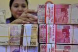 Nilai tukar rupiah ditutup melemah di tengah perkembangan paket stimulus AS
