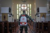 Penyemprotan disifektan di gereja