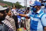 Demokrat Peduli Corona Periksa Suhu Badan Warga Jayapura