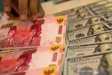 Rupiah bergerak menguat 207 poin seiring stimulus besar-besaran pemerintah AS