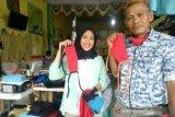 Konveksi di Palembang produksi  ribuan masker gratis