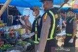 Cegah Corona, Satgas Polda Sulawesi Tenggara lakukan edukasi pasar tradisional