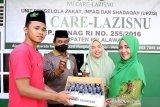 Muslimat NU Pelalawan ganti harlah dengan bagikan 3.000 hand sanitizer, begini penjelasanya