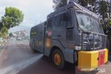 Polres Solok Kota kembali semprotkan disinfektan di belasan titik cegah COVID-19