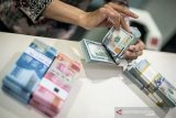 Rupiah menguat, ekonomi China mulai pulih