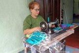 Masker kain kurang efektif cegah penularan COVID-19, kata dokter