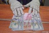Rupiah  Rabu sore melemah dipicu kembalinya pasar ke aset safe haven