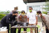 Polri cek suhu tubuh pengendara ojek online menggunakan drone