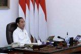 Presiden Jokowi menetapkan pandemi COVID-19 sebagai bencana nasional