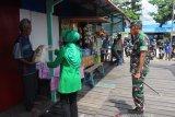 Persit Kodim 0913/PPU bagikan masker dan beras kepada masyarakat
