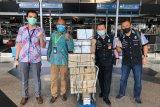 10.000 sarung tangan latex dikirim dari Kuala Lumpur
