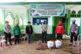 Polda-LPBI NU Papua semprot cairan disinfektan di perumahan warga