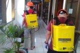 Satgas COVID-19 laksanakan penyemprotan disinfektan di kantor Kejati Sulut