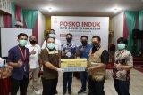 Grup Nurani Astra Makassar bagikan sabun tangan dan masker kepada warga