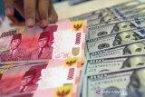 Kurs Rupiah ditutup menguat seiring harapan lolosnya paket stimulus di AS