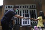 Garda Pemuda Nasdem NTT bagikan ribuan masker di Kupang