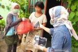 Komunitas Jurnalis salurkan bantuan masker dan bahan pokok di Makassar
