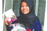 Kartini juga Cari_Aman saat naik motor