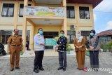Bupati Kampar terima bantuan APD dari RAPP, APR, dan Asian Agri