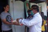 Warga Padang Panjang: bantuan berupa beras meringankan beban kami