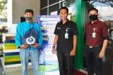 SP BPJAMSOSTEK Ungaran donasikan sembako dan masker ke pengemudi ojek
