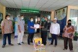 Satgas COVID-19 NU NTB menyerahkan APD untuk tim medis