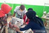 BRG berdayakan masyarakat tiga kabupaten di Sumsel produksi masker
