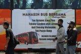 Aksi bersama memanasi mesin bus