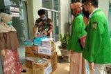 Laksanakan KKN tematik, mahasiswa Kedokteran  Unand buat dan sumbangkan APD