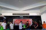 Alfamidi bantu bagikan ribuan paket sembako di Manado