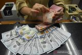 Rupiah Senin pagi menguat 65 poin jadi Rp14.370 per dolar AS