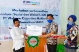 WOM Finance bagikan Al Quran ke pondok pesantren di  Kudus