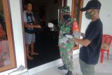 Kodim Sangihe membagi masker gratis