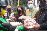 LMI berbagi kasih dengan masyarakat terdampak COVID-19 di Manado