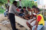 Supir dan tukang ojek di Jayapura terima bantuan masker gratis dari polisi
