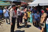 Satgas Binmas Operasi Aman Nusa Polda Sulut sumbang masker kepada warga
