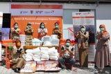 Yayasan WVI serahkan paket APD untuk Pukesmas di Kota Palu