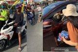 GPdI Ampana bagi 1.000 masker kepada pengendara bermotor