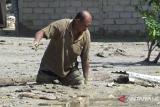 Belasan rumah warga tertimbun lumpur satu meter, akses jalan Palu-Sigi terputus