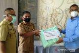 Disnakertrans Solok Selatan berdayakan TKM buat masker