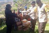 Polres Tolikara beri bantuan sembako dan masker kepada warga terdampak Corona