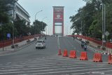 Perbandingan suasana pusat Kota Palembang pada Idul Fitri hari ini dan tahun lalu